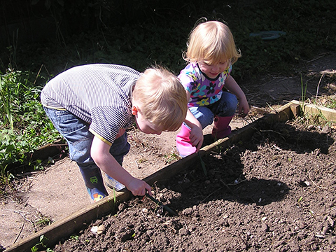 playing in the soil one of the best sensory play ideas for plants and seeds
